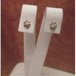 Oorbellen ~ Gouden 14 karaats oorbellen knopjes met Diamant
