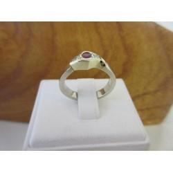 Ring ~ Gouden 14 karaats ring met robijn & Diamant