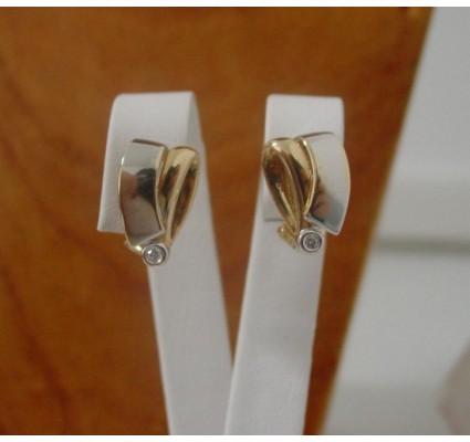 Oorbellen ~ Gouden 18 karaats oorbellen met Diamant